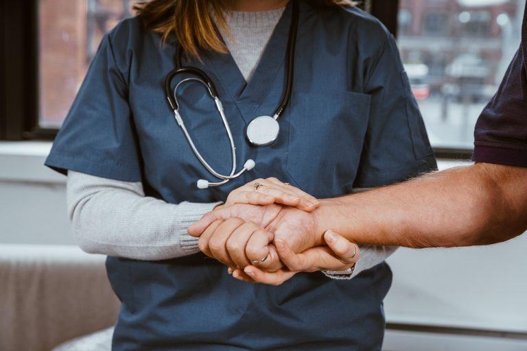 nurse hands abacare insurance brokers